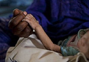A mother attends to her severely malnourished child at an inpatient feeding centre in Mao, Chad. Plumpy'Nut is used to treat this potentially deadly condition (UNICEF Chad/2011/ Esteve)