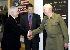 "Former Defense Secretary Robert M. Gates, left, and Mike Rhodes, greet retired Air Force Col. Gail Halvorsen, right, prior to the dedication of the Defense Humanitarian Relief Corridor in the Pentagon, May 19, 2009. During the Berlin Airlift, Halvorsen earned the nickname ""Candy Bomber"" for his dropping candy-laden parachutes from his aircraft to Berlin children. (DoD photo by Navy Petty Officer 1st Class Molly A. Burgess"